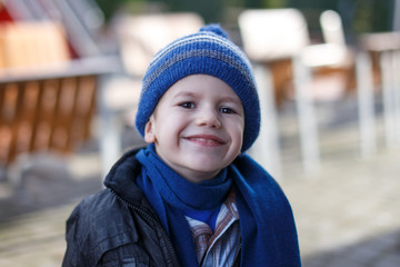 Little boy in winter cap and scarf