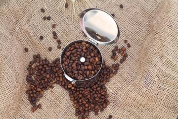 Coffeepot with coffee beans on canvas.Top view.jpg