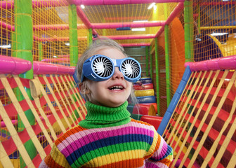 Little girl in party glasses