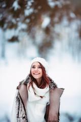 Winter woman looking up happy