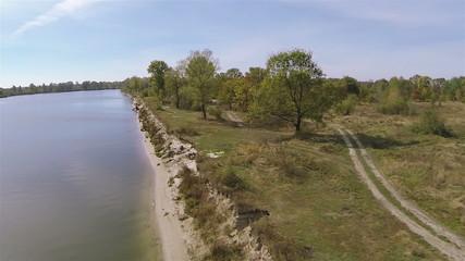 Flight  over river un  bright sunny day. Aerial Landscape