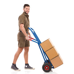Messenger walking with a delivery cart