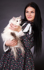 Young attractive woman with a cat