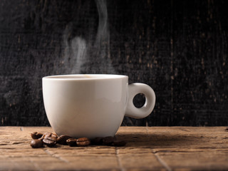 Cup of hot espresso coffee and coffee crop