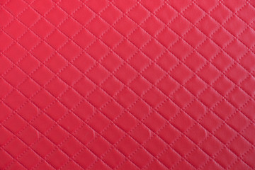 Red leather texture close up.