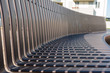 Empty black metal bench in public gardens
