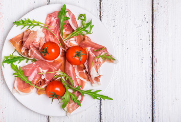 Prosciutto with arugula and cherry tomatoes