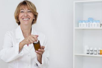Happiness mature female pharmacist portrait