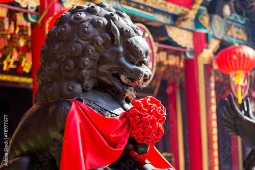 Poster Lion statue in Chinese temple