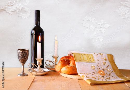 Fotobehang Brood shabbat image. challah bread, shabbat wine and candelas on woode