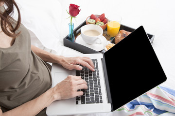 woman hands typing and breakfast