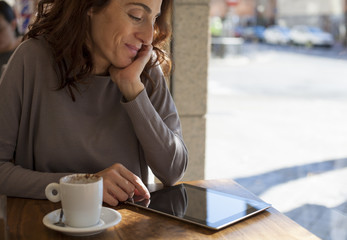woman tablet in cafe horizontal