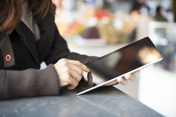 woman with tablet in a market