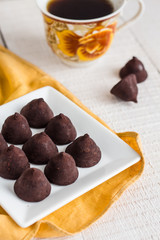 truffle chocolates with a cup of coffee and cream