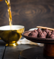 truffle chocolates, pouring coffee into a cup