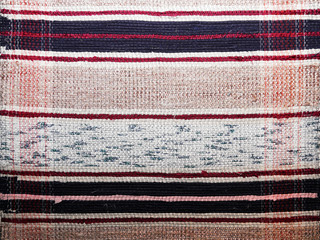 textile background (homespun rug)