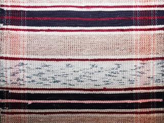 textile background (homespun rug)