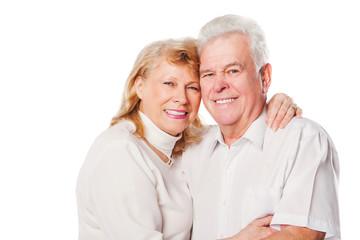 Happy senior loving couple over white background