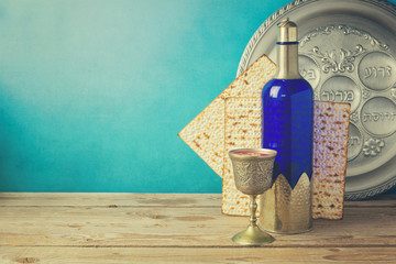 Passover background with matzo and wine on vintage table.
