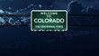 Colorado USA State Welcome to Highway Road Sign at Night