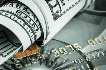 Background of dollars and bank cards