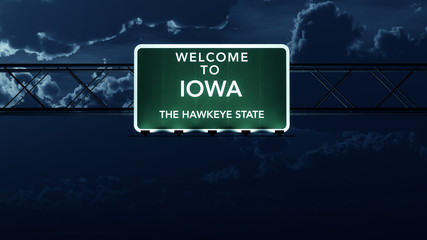 Iowa USA State Welcome to Highway Road Sign at Night