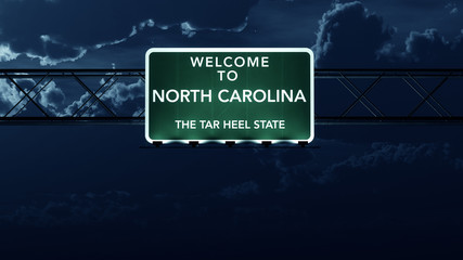 North Carolina USA State Welcome to Highway Road Sign at Night