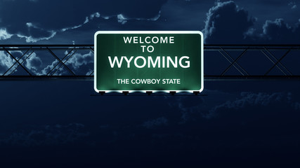 Wyoming USA State Welcome to Highway Road Sign at Night