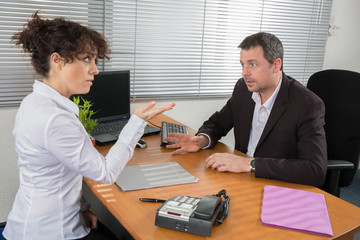 A man,  job applicant having an interview with a woman