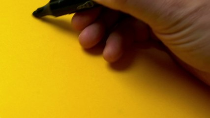 The man draws on yellow paper Merry man