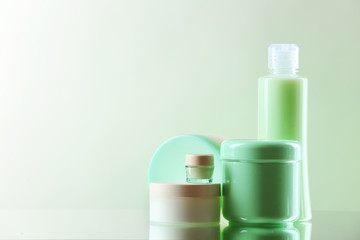 Cosmetic bottles on light background
