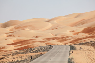 Road through the desert in Liwa Oasis area, UAE