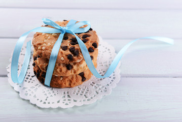 Tasty cookies on color wooden background