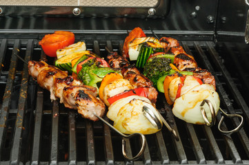 skewer of grilled vegetable and meat
