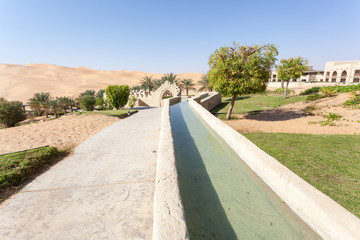 Irrigation canal in a desert resort. Emirate of Abu Dhabi