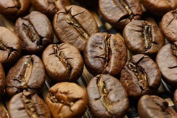 Roasted coffee beans macro shot with extended DOF, hard light