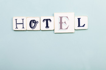 Hotel signboard. Handwritten colors letters blue background