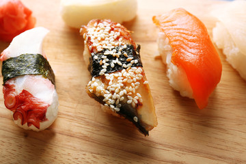 Sushi on board on wooden table background