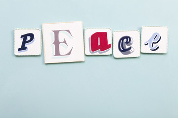 Peace signboard. Handwritten colors letters blue background