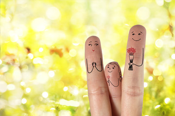 Finger art. Father and daughter are giving flowers his mother.