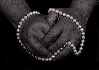 Hand and pearls