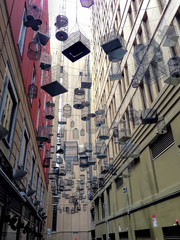 Many Hanging Cage Between Buildings