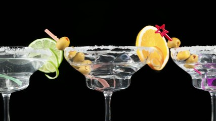 Pan zoom of alcoholic cocktails on black background