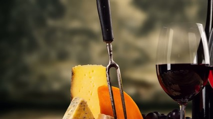 Pan zoom of French cheese and red wine