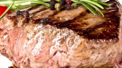 Pan zoom of beef steak on white background