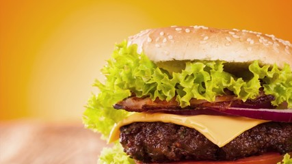 Pan zoom of hamburger served on wood