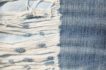 Closeup of tear in old jeans.