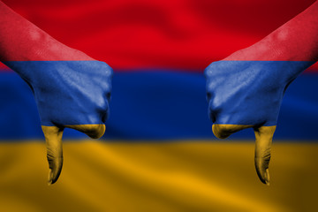 failure of Armenia - hands gesturing thumbs down in front of fla