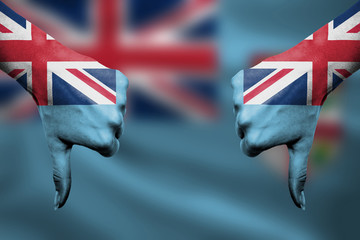 failure of Fiji - hands gesturing thumbs down in front of flag