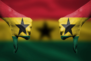 failure of Ghana - hands gesturing thumbs down in front of flag